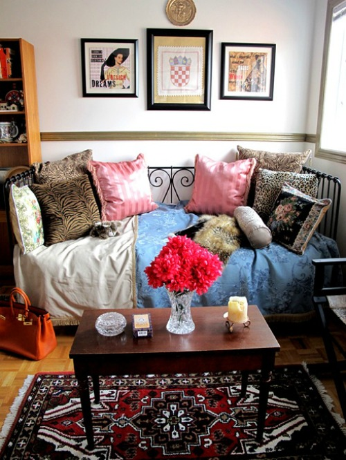 Bohemain living room with lots of pillows and patterned rug