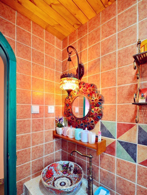Colorful tiles and mosaics in this bright bohemian bathroom