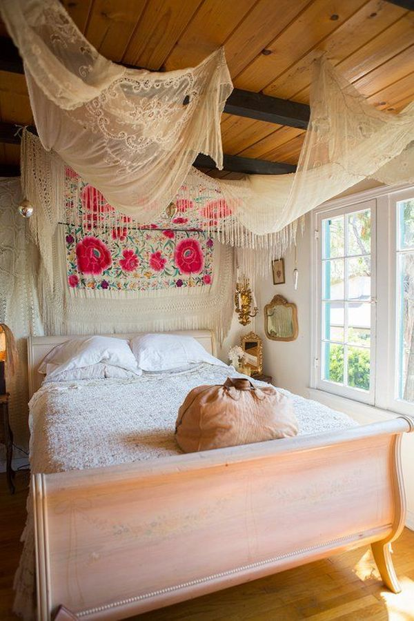 Fabrics above bed make cozy atmosphere in this boho bedroom